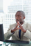 Portrait of a serious office worker using a computer Royalty Free Stock Photography
