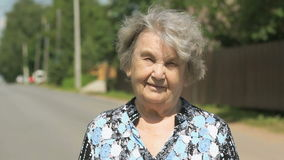 Portrait of serious old elderly woman outdoors stock footage