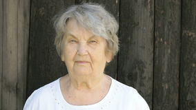 Portrait of serious old gramma aged 80s outdoors stock video footage