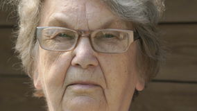 Portrait of serious old gramma aged 80s outdoors stock footage
