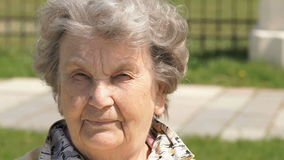 Portrait of serious old gramma aged 80s outdoors stock video