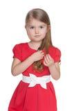 Portrait of a serious preschool girl Stock Image