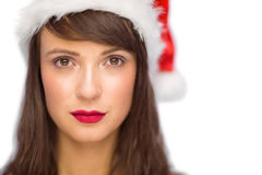 Portrait of serious pretty young woman in santa costume Royalty Free Stock Images