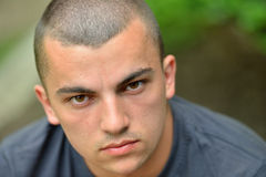 Portrait of serious and sad handsome young man outdoors in natur Royalty Free Stock Photos