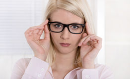 Portrait of serious secretary with glasses. Royalty Free Stock Photography
