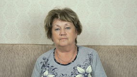 Portrait of serious senior woman with harsh look stock video
