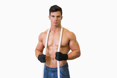 Portrait of a serious shirtless young muscular man Stock Images