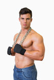 Portrait of a serious shirtless young muscular man Royalty Free Stock Photos