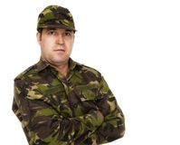Portrait of a serious soldier standing against Royalty Free Stock Photo