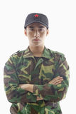 Portrait of Serious Solider With Arms Crossed, Studio Shot, Waist Up Stock Photos