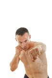 Portrait of serious sportsman boxer fihter in fight position Royalty Free Stock Photo