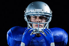 Portrait of serious sportsman holding helmet Stock Photography