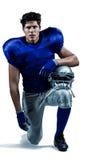 Portrait of serious sportsman holding helmet Royalty Free Stock Image