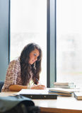 Portrait of a serious student writing Stock Images