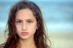 Portrait of a serious teen girl. On the beach Stock Photography
