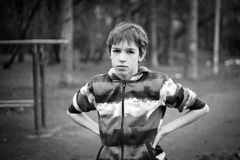 Portrait of serious teenage boy. B & w Stock Photos