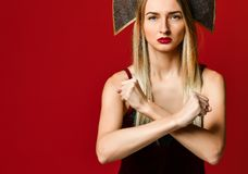 Woman showing a stop arms crossed. On a red background. royalty free stock image