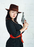 Woman in brown hat with gun Royalty Free Stock Images