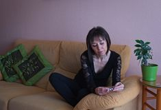 Portrait of serious woman in the living room royalty free stock image