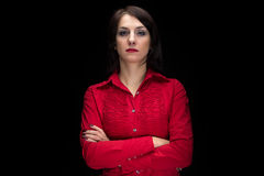 Portrait serious woman in shirt with arms crossed Royalty Free Stock Photography