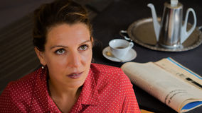 Portrait of a serious woman at tea time looking to the top Royalty Free Stock Photo