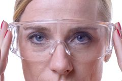Portrait of a serious woman wearing safety eyewear royalty free stock photos