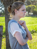 Portrait of serious young blonde woman looking ahead and away fr Stock Images