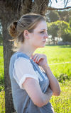 Portrait of serious young blonde woman looking ahead and away fr Stock Image