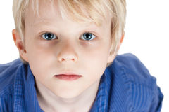 Portrait of a serious young boy Stock Images