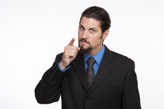 Portrait of a serious young businessman pointing at camera Royalty Free Stock Photography