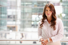 Portrait of a serious young businesswoman, waist up Royalty Free Stock Photo