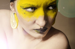 The girl in yellow make-up Stock Image