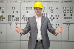 Portrait of serious young male supervisor gesturing in control room Stock Photography