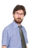 Portrait of a serious young man in glasses Stock Photos
