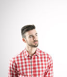 Portrait of serious young man in plaid shirt looking away Royalty Free Stock Photos