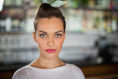 Portrait of serious young woman in cafe Royalty Free Stock Photography