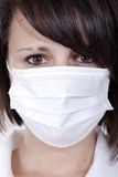 Portrait of serious young woman doctor. In scrubs with mask Royalty Free Stock Images