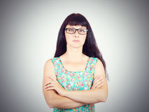 Portrait of a serious young woman with glasses Royalty Free Stock Image