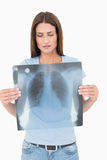 Portrait of a serious young woman holding lung xray Stock Photos
