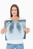 Portrait of a serious young woman holding lung xray Royalty Free Stock Photography