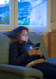 Portrait of a serious young woman using mobile phone Royalty Free Stock Photos