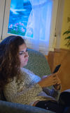 Portrait of a serious young woman using mobile phone Royalty Free Stock Photography