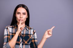 Portrait serious youth youngster place finger mouth want conspiracy news novelty advice decision recommend display tip. Confident stylish trendy checked shirt royalty free stock photo