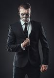 Portrait seriousbusinessman  makeup skeleton Stock Images