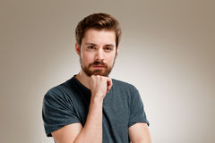Portrait of seriously young man with beard Royalty Free Stock Photo