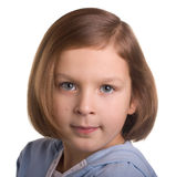 Portrait of seven year old girl. Over white Royalty Free Stock Photography