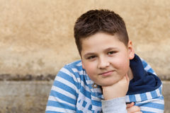 Portrait of a seven years old young caucasian boy Stock Image