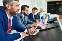 Mature Businessman in Political Press Conference stock photography