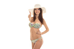 Portrait of sexual brunette girl in swimsuit and straw hat showing thumbs up isolated on white background. summer Stock Photos