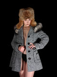 Portrait of sexual girl in gray coat and fur hat Stock Photos